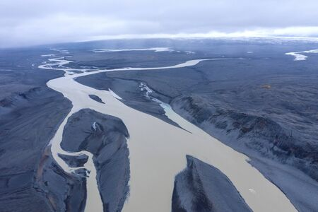 Aerial drone view of a huge riverbed, melting glacier, Iceland. Global warming and climate change concept