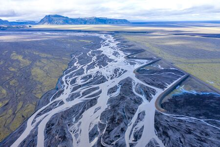 Aerial drone view of a huge riverbed, melting glacier, Iceland. Global warming and climate change concept Archivio Fotografico