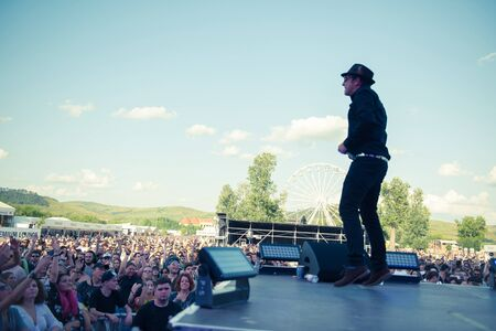 BONTIDA, ROMANIA - JULY 19, 2019: English electronic music group Dub Pistols performing a live concert on the Main Stage of Electgric Castle festival 報道画像