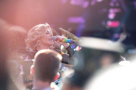 BONTIDA, ROMANIA - JULY 20, 2019: Romanian pop singer-songwriter Loredana singing live in the middle of the crowd at Electric Castle Festival
