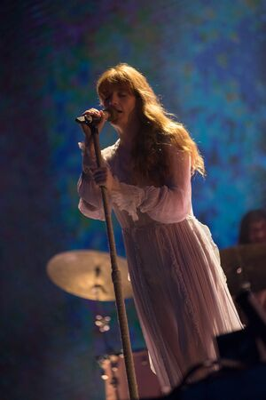 BONTIDA, ROMANIA - JULY 19, 2019: Singer of Florence and the Machine English indie rock band singing live on the stage during a concert at Electric Castle festival