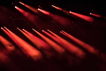 Red stage lights at music festival