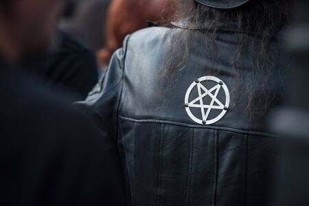 Satanic pentagram sign on a leather jacket at rock festival Stock Photo