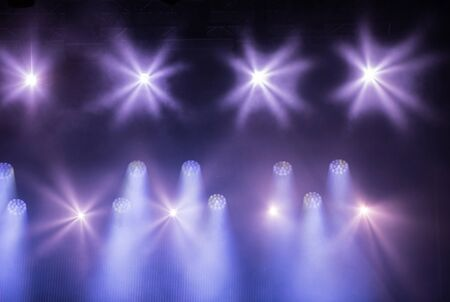 Purple stage lights at music festival Stock Photo