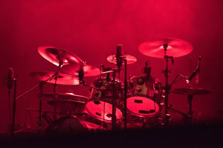 Drum kit in red stage lights Stock Photo