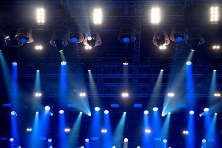 Blue stage lights at music festival Stock Photo