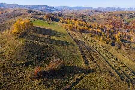 Aerial drone shot over autumn scenery in Transylvania, Romania