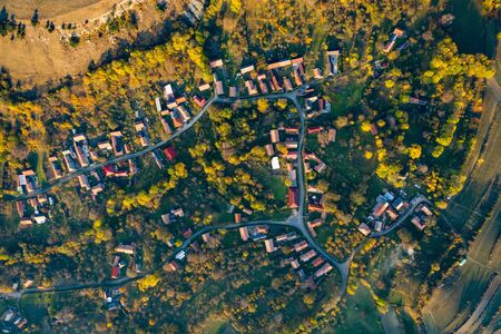 High angle aerial view of a small village, autumn countryside in Transilvania, Romania