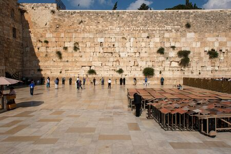 JERUSALEM, ISRAEL - MAY 15, 2018: People visiting and praying at the Western Wall, or Wailing Wall, part of the Second Jewish Temple built by Herod the Great Publikacyjne