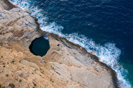 Aerial drone view of Giola lagoon, a natural seaside pool in Thassos, Greece