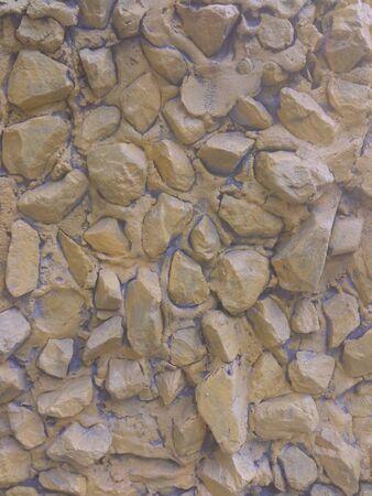 Yellow brick wall. Stone background.
