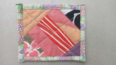 Colorful handmade textiles. Colored fabric patchwork background. Patchwork background. Multicolored patchwork knitted background.