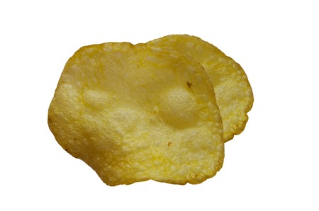 titbits: Potato chips on white isolated background close-up Stock Photo