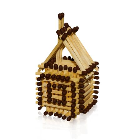 unsound: toy house made of matches on a white background