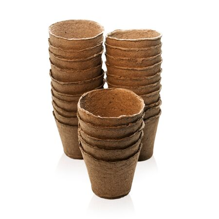 turba: Peat pots isolated over white Foto de archivo