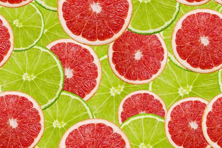 Rebanadas de limón fresco y pomelo textura fondo de patrones sin fisuras
