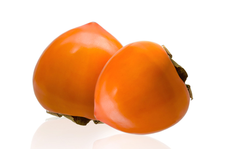 Two of ripe persimmon fruits isolated on white background. Clipping path