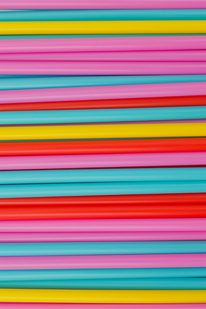 rainbow cocktail: Abstract background from many multi-color straws. vertical