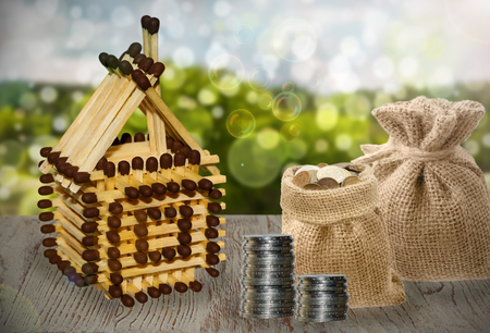 House model and coin money on table for finance and banking concept. Stock Photo