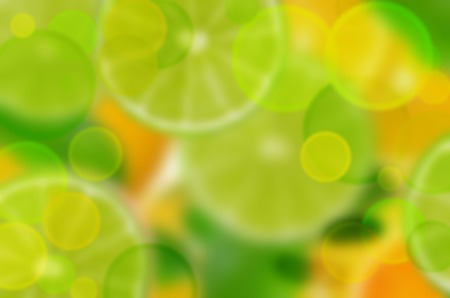 The fruits are bright yellow-green blurred background. Fresh sliced citrus fruits background. Lime, lemon, orange.
