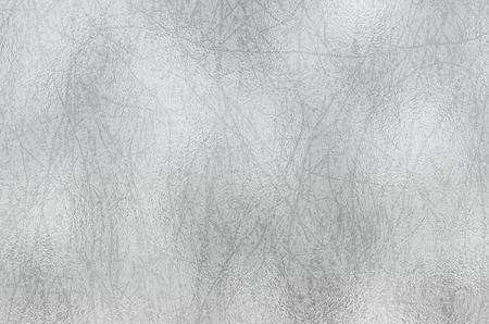 Shiny silver foil texture, grey metallic decorative background