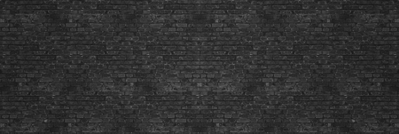 Vintage Black wash brick wall texture for design. Panoramic background for your text or image.
