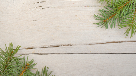 Christmas gifts, fir tree branches on white wooden table, background. Christmas composition. Flat lay, frame