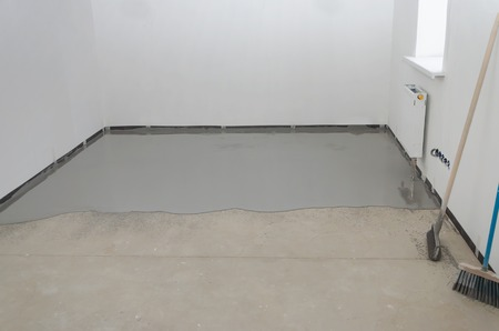 Self-leveling epoxy. Leveling with a mixture of cement floors. Stock Photo