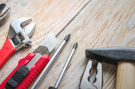 Carpenter working tools set on old vintage wooden background. Tools and workbench from the workshop.
