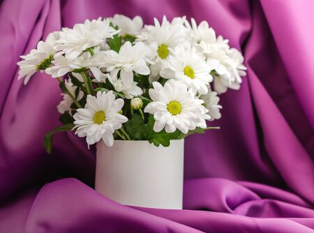 Flowers on the table close-up. White chrysanthemums in a vase