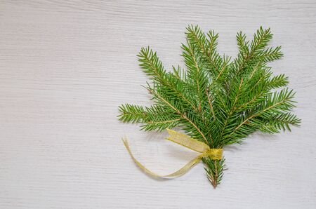 Christmas white wooden background with snow fir tree. Top view with copy space for your text Stockfoto