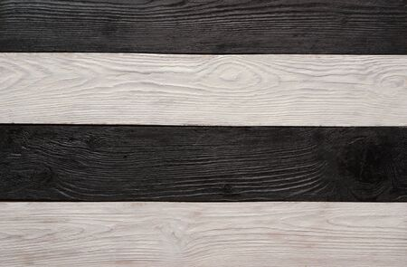 Wooden dark, black and white textured backdrop. Striped blank background with space for text. Flat lay, top view, copy space.