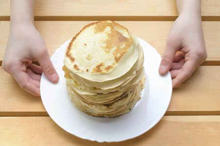 Stack of delicious pancakes on plate. Close up