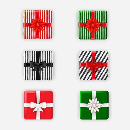 Set of Christmas multi-colored gift boxes with bows and ribbons, top view. Vector illustration. 版權商用圖片