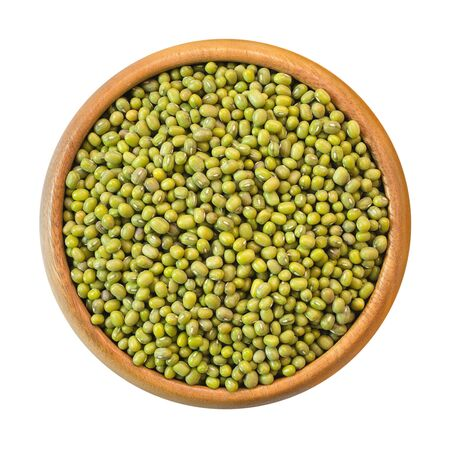 Green mung bean in wooden bowl, isolated on white background. Top view.