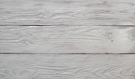 Wooden white textured background. Flat lay, top view, copy space