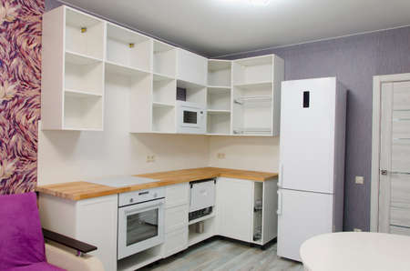 Installation of kitchens, repair of the apartment. White kitchen cabinets. Interior design