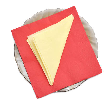 Paper napkins on the black plate, isolated on white photo