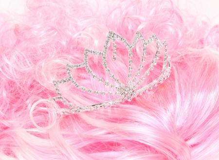 shiny tiara on a pink background wig. photo