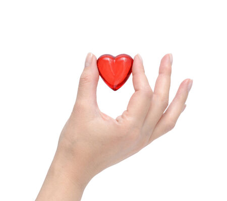 Heart in the hand isolated on white. photo
