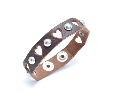 leather bracelet rock n roll style, isolated on white. photo