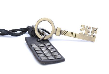 Old key isolated on white background photo