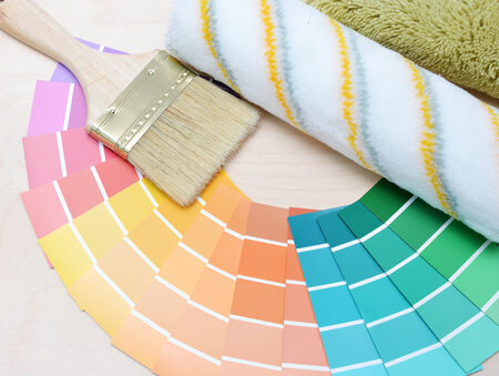 color palette and brush on a wooden background. photo