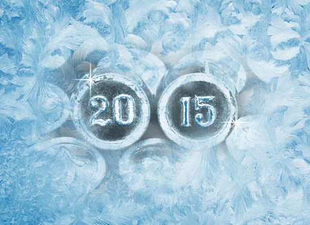 Frozen window patterns. Happy New year 2015. Photo of the numbers photo