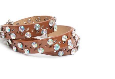 Many fashion bracelets on white background photo