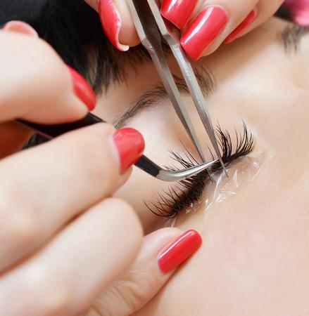 false eyelashes: Beautiful young woman in eyelash extension Stock Photo