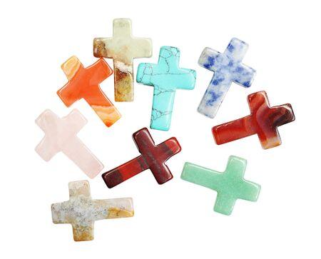 piedras preciosas: Cruces de piedras semi preciosas aislados en fondo blanco Foto de archivo