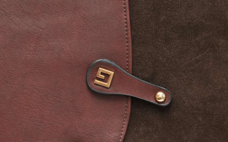 Brown suede and leather close up background.