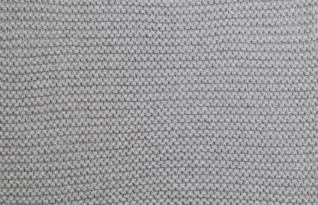 cable stitch: Handmade grey knitting wool texture background