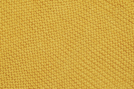 cable stitch: Handmade yellow knitting wool texture background Stock Photo